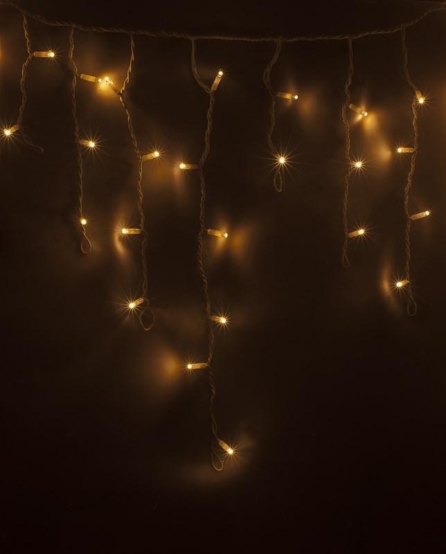 Гирлянда Neon-Nigh Айсикл, светодиодная бахрома, цвет: белый, тепло-белый, 4,8 х 0,6 м255-138Гирлянда Айсикл плей-лайт - это световой дождь с нитями разной длины. Она имитирует сосульки и может послужить эффектным и оригинальным решением при декорировании карнизов домов, оконных проемов, арок и других элементов как фасадов здания, так и интерьеров внутренних помещений. Благодаря использованию в гирлянде светодиодов ее отличительной особенностью является изрядная яркость и низкое энергопотребление. Цвет свечения теплый белый. Цвет провода белый. Степень влагозащиты позволяет использование на улице. При длине 4,8 метра гибкая направляющая имеет 48 нитей длиной от 20 до 60 см.