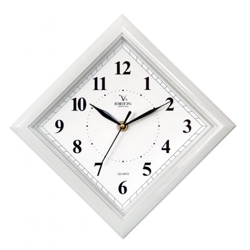 """Оригинальные настенные часы Вега """"Классика. Ромб в сером"""" выполнены из пластика. Часы имеют три стрелки - часовую, минутную и секундную. Необычное дизайнерское решение и качество исполнения придутся по вкусу каждому. Оформите свой дом таким интерьерным аксессуаром или преподнесите его в качестве презента друзьям, и они оценят ваш оригинальный вкус и неординарность подарка.       Часы работают от 1 батарейки типа АА напряжением 1,5 В (в комплект не входит)."""