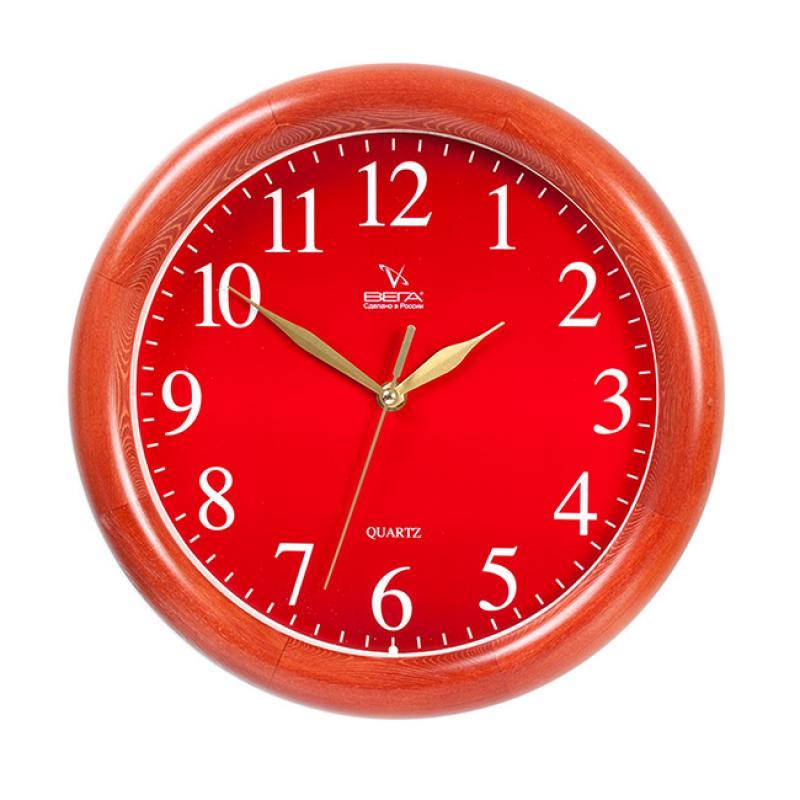 Часы настенные Вега Классика, цвет: бордовый. Д1КД/7-55Д1КД/7-55Оригинальные настенные часы круглой формы Вега Классика выполнены из дерева и пластика. Часы имеют три стрелки - часовую, минутную и секундную. Необычное дизайнерское решение и качество исполнения придутся по вкусу каждому. Оформите свой дом таким интерьерным аксессуаром или преподнесите его в качестве презента друзьям, и они оценят ваш оригинальный вкус и неординарность подарка. Часы работают от 1 батарейки типа АА напряжением 1,5 В (в комплект не входит).