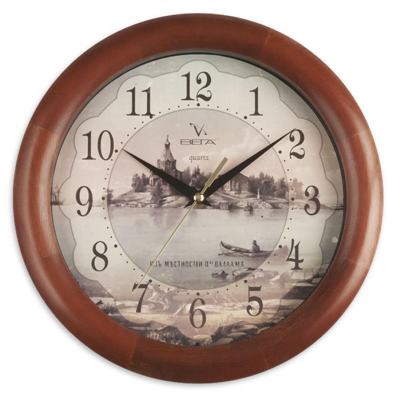 Часы настенные Вега Старый городД1МД/6-138Оригинальные настенные часы круглой формы Вега Старый город выполнены из дерева и пластика. Часы имеют три стрелки - часовую, минутную и секундную. Необычное дизайнерское решение и качество исполнения придутся по вкусу каждому. Оформите свой дом таким интерьерным аксессуаром или преподнесите его в качестве презента друзьям, и они оценят ваш оригинальный вкус и неординарность подарка.Часы работают от 1 батарейки типа АА напряжением 1,5 В (в комплект не входит).