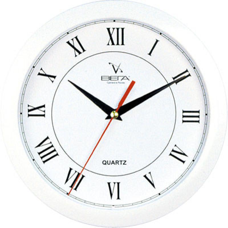 """Оригинальные настенные часы круглой формы Вега """"Римская классика"""" выполнены из пластика. Часы имеют три стрелки - часовую, минутную и секундную. Необычное дизайнерское решение и качество исполнения придутся по вкусу каждому. Оформите свой дом таким интерьерным аксессуаром или преподнесите его в качестве презента друзьям, и они оценят ваш оригинальный вкус и неординарность подарка.       Часы работают от 1 батарейки типа АА напряжением 1,5 В (в комплект не входит)."""