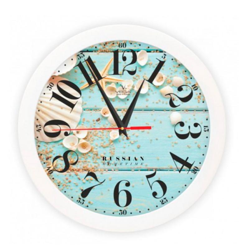 """Оригинальные настенные часы круглой формы Вега """"Ракушки"""" выполнены из пластика. Часы имеют три стрелки - часовую, минутную и секундную. Необычное дизайнерское решение и качество исполнения придутся по вкусу каждому. Оформите свой дом таким интерьерным аксессуаром или преподнесите его в качестве презента друзьям, и они оценят ваш оригинальный вкус и неординарность подарка.       Часы работают от 1 батарейки типа АА напряжением 1,5 В (в комплект не входит)."""