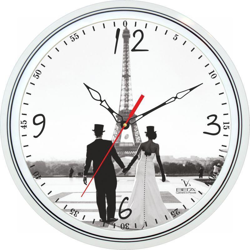 Часы настенные Вега Влюбленные в ПарижеП1-763/7-130Оригинальные настенные часы круглой формы Вега Влюбленные в Париже выполнены из пластика. Часы имеют три стрелки - часовую, минутную исекундную. Необычное дизайнерское решение и качество исполнения придутся по вкусу каждому.Оформите свой дом таким интерьерным аксессуаром или преподнесите его в качестве презента друзьям, и они оценят ваш оригинальный вкус инеординарность подарка.