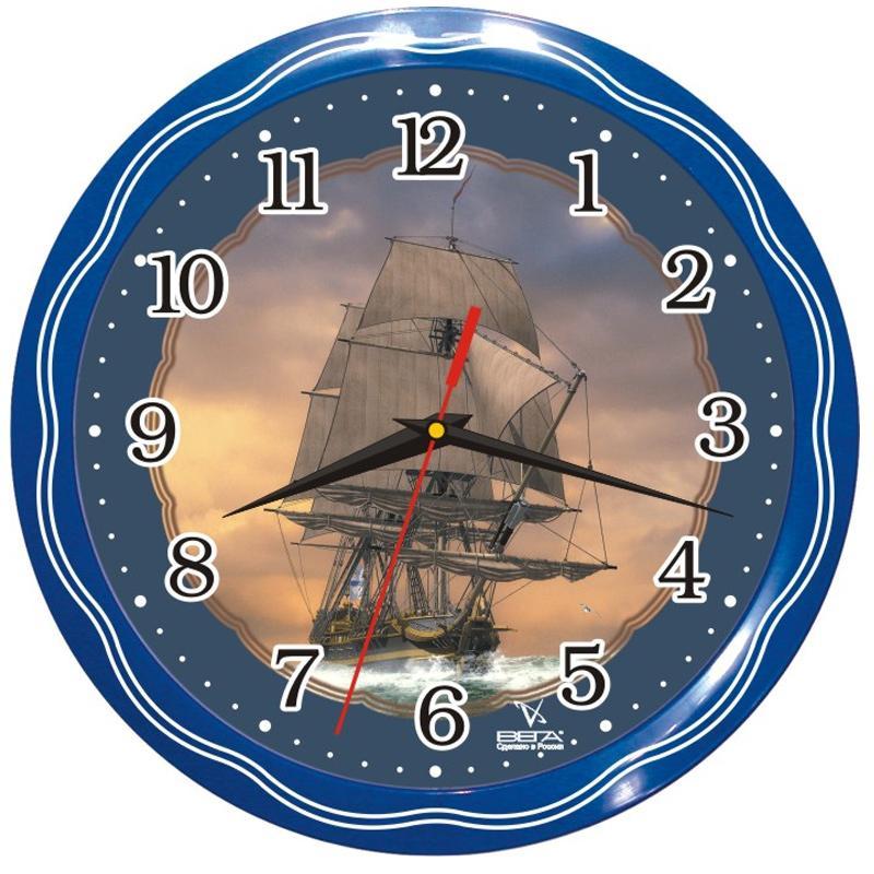 """Оригинальные настенные часы круглой формы Вега """"Фрегат"""" выполнены из пластика. Часы имеют три стрелки - часовую, минутную и секундную. Необычное дизайнерское решение и качество исполнения придутся по вкусу каждому. Оформите свой дом таким интерьерным аксессуаром или преподнесите его в качестве презента друзьям, и они оценят ваш оригинальный вкус и неординарность подарка."""