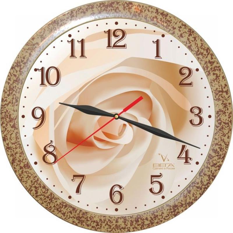 """Оригинальные настенные часы круглой формы Вега """"Бежевая роза"""" выполнены из пластика. Часы имеют три стрелки - часовую, минутную и  секундную. Необычное дизайнерское решение и качество исполнения придутся по вкусу каждому.  Оформите свой дом таким интерьерным аксессуаром или преподнесите его в качестве презента друзьям, и они оценят ваш оригинальный вкус и  неординарность подарка."""