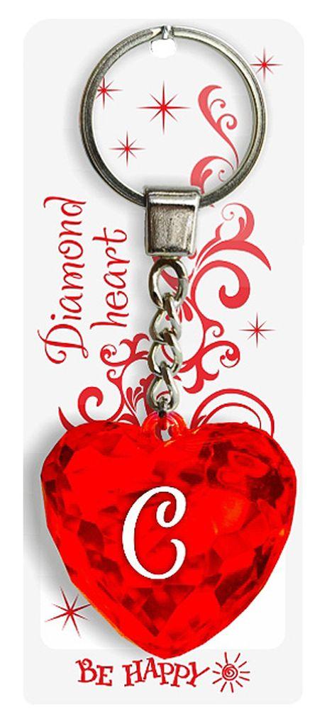 Брелок Be Happy Диамантовое сердце. С80Оригинальный брелок Be Happy Диамантовое сердце, изготовленный из высококачественного пластика, станет отличным подарком. Это не только приятный, но и практичный сувенир для каждодневного использования, ведь такое хрустальное сердце - не просто брелок, а модный аксессуар. Брелоком можно украсить сумочку, детскую коляску или повесить на ключи. Переливающиеся грани и блестящая поверхность создадут гламурный образ. Длина цепочки - 4 см. Диаметр кольца - 2 см.