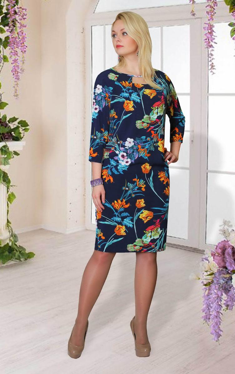 Платье Milana Style, цвет: темно-синий, мультиколор. 865м. Размер XL (50)865мПлатье Milana Style выполнено из полиэстера с добавлением вискозы и лайкры. Платье-миди с круглым вырезом горловины и рукавами-реглан длиной 3/4. На груди и на спинке расположены декоративные вырезы. Платье оформлено цветочным принтом.