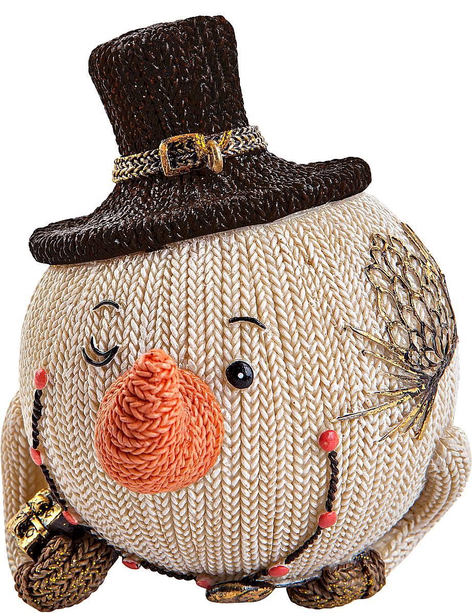 Статуэтка Mister Christmas Снеговик в шляпе, высота 10 смSM-22BСтатуэтка Mister Christmas Снеговик в шляпе выполнена из полистоуна в виде забавного снеговика. Она привлекает к себе внимание и буквально умиляет, заставляя улыбнуться.Такой сувенир станет отличным подарком родным или друзьям на Новый год, а также он украсит интерьер вашего дома или офиса.Высота статуэтки: 10 см.
