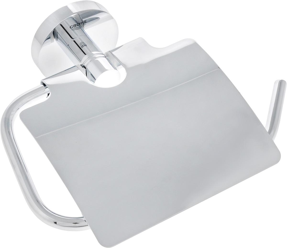 """Держатель для туалетной бумаги с крышкой Grohe """"Essentials New"""" выполнен из высококачественного металла. Благодаря строгому и лаконичному дизайну, а также ослепительному хромированному покрытию StarLight он будет великолепно смотреться в интерьере вашей ванной комнаты долгие годы. Изделие крепится к стене при помощи шурупов (входит в комплект)."""