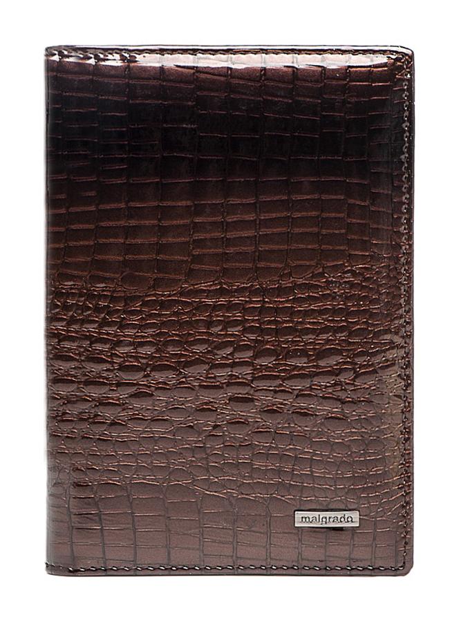 Обложка для паспорта и автодокументов Malgrado, цвет: коричневый. 54019-1-01411Натуральная кожаОбложка для паспорта и автодокументов Malgrado не только поможет сохранить внешний вид ваших документов и защитить их от повреждений, но и станет стильным аксессуаром, идеально подходящим вашему образу. Обложка выполнена из натуральной лаковой кожи высокого качества. На внутреннем развороте имеются пять наборных кармашков для кредиток или визитных карточек, съемный блок из шести прозрачных файлов из мягкого пластика, один из которых формата А5 и вертикальный карман из прозрачного пластика.Обложка упакована в фирменную картонную коробку. Характеристики: Материал: натуральная кожа, пластик.Цвет: коричневый.Размер обложки: 9,5 см х 13,5 см х 2 см.Размер упаковки: 15,5 см х 11,5 см х 3 см.Артикул: 54019-1-01411.