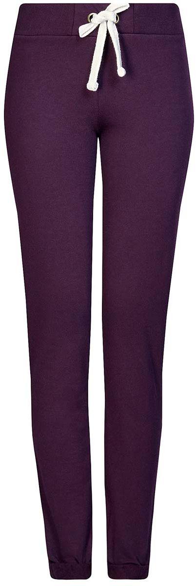 Брюки спортивные женские oodji Ultra, цвет: темно-фиолетовый. 16701010B/46980/8800N. Размер XS (42)16701010B/46980/8800NСпортивные женские брюки oodji Ultra выполнены из натурального хлопка. Изнаночная сторона изделия с мягким начесом. Модель имеет широкую резинку на поясе, объем талии регулируется при помощи шнурка-кулиски. Сзади брюки дополнены имитацией прорезного кармана. Снизу брючины оснащены декоративными отворотами на резинках.