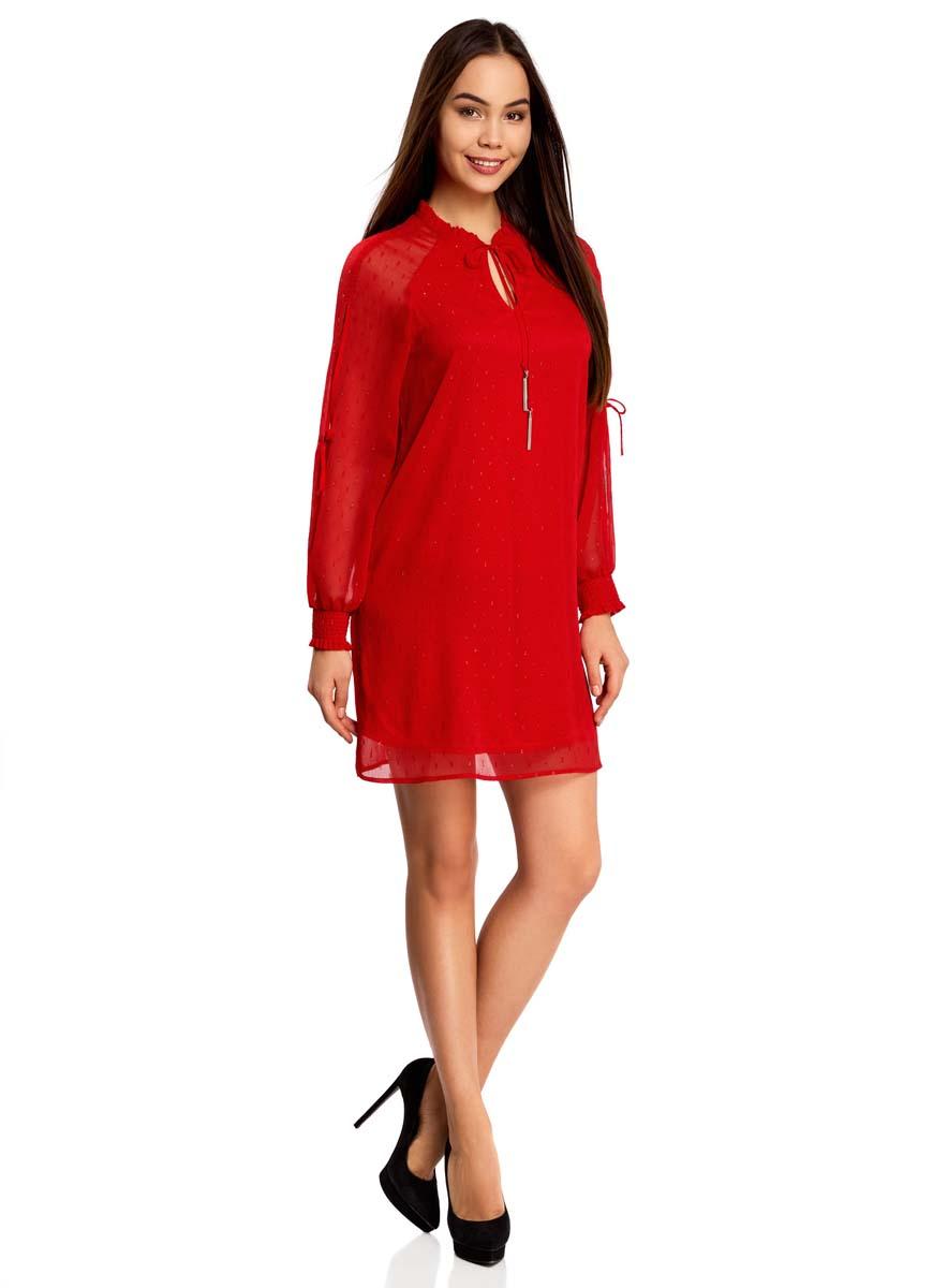 Платье oodji Ultra, цвет: красный. 11914001/46116/4500N. Размер 40 (46-170)11914001/46116/4500NСтильное платье oodji Ultra выполнено из качественного полиэстера. Подкладка изделия также изготовлена из полиэстера. Модное шифоновое платье-мини с круглым вырезом горловины и длинными рукавами-реглан дополнена спереди завязками. Рукава модели дополнены манжетами на широких резинках и оригинальными прорезями вдоль рукава с завязками-бантиками. Вырез горловины оформлен нежной рюшей.