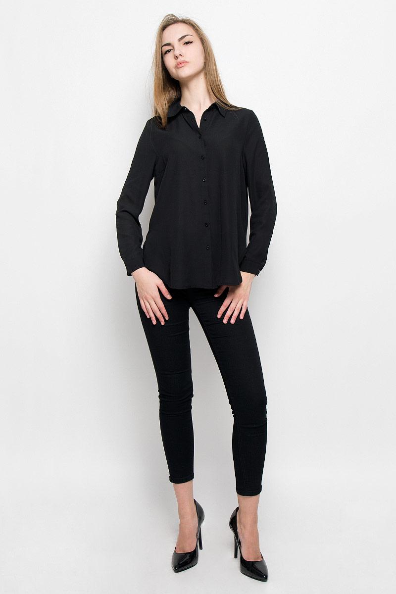 Блузка женская Broadway Shala, цвет: черный. 10156770_999. Размер L (48)10156770_999Модная женская блузка Broadway Shala изготовлена из высококачественного полиэстера.Модель свободного кроя с отложным воротником и длинными рукавами застегивается на пуговицы по всей длине. Нижняя часть изделия по боковым швам дополнена разрезами. Манжеты рукавов оснащены застежками-пуговицами.