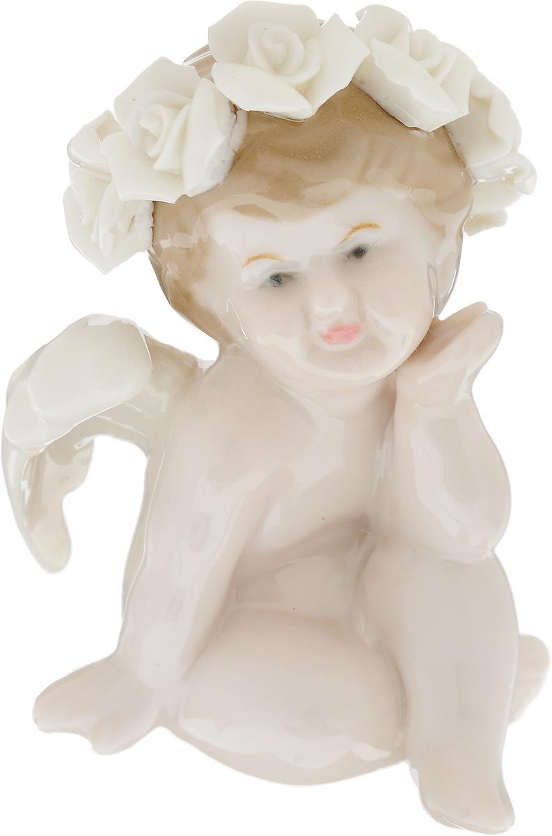Фигурка декоративная Win Max Ангел, высота 8 см. 1082610826Декоративная фигурка Win Max Ангел, выполненная в виде ангелочка, будет вас радовать и достойно украсит интерьер вашего дома или офиса. Фигурка изготовлена из глазурованного фарфора. Вы можете поставить украшение в любом месте, где оно будет удачно смотреться и радовать глаз. Кроме того, эта фигурка - отличный вариант подарка для ваших близких и друзей.