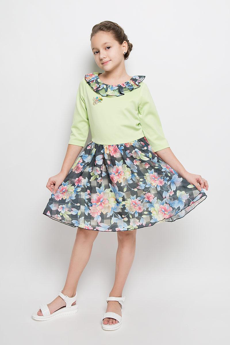 Платье для девочки Nota Bene, цвет: салатовый, темно-серый, мультиколор. ND6506-77. Размер 164ND6506-77Платье для девочки Nota Bene выполнено из 100% полиэстера и дополнено подкладкой из натурального хлопка. Платье-миди с круглым вырезом горловины и рукавами длинной 3/4 застегивается на потайную застежку-молнию расположенную в среднем шве спинки. Юбка модели дополнена мягкими складками и оформлена цветочным принтом. Платье по горловине дополнено оборкой и декоративной брошью.