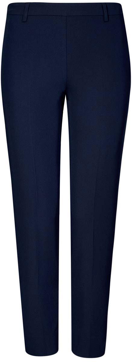 Брюки женские oodji Collection, цвет: темно-синий. 21706022-1/18600/7900N. Размер 42 (48-170)21706022-1/18600/7900NСтильные женские брюки oodji Collection изготовлены из качественного комбинированного материала. Модель зауженного кроя со стандартной посадкой выполнена в лаконичном стиле и дополнена по низу брючин небольшими разрезами. Застегиваются брюки по боковому шву на застежку-молнию и потайную пуговицу, а также дополнены в поясе шлевками для ремня. Сзади изделие оформлено имитацией прорезного кармана.