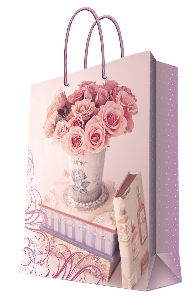 Пакет подарочный Magic Home Ваза с розами, 17,8 х 22,9 х 9,8 см44179Бумажный подарочный пакет Magic Home Нотр-Дам, изготовленный из плотной бумаги, станет незаменимым дополнением к выбранному подарку. Дно изделия укреплено картоном, который позволяет сохранить форму пакета и исключает возможность деформации дна под тяжестью подарка. Пакет выполнен с ламинацией, что придает ему прочность, а изображению - яркость и насыщенность цветов. Для удобной переноски имеются две ручки в виде шнурков. Подарок, преподнесенный в оригинальной упаковке, всегда будет самым эффектным и запоминающимся. Окружите близких людей вниманием и заботой, вручив презент в нарядном, праздничном оформлении.Плотность бумаги: 140 г/м2.