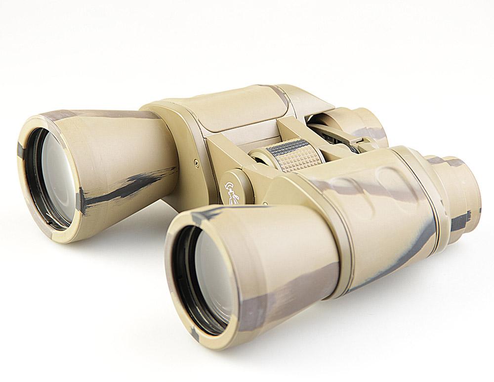 Бинокль Veber Classic, цвет: камуфляж, БПШЦ 10x50 VRWA10966Классический универсальный бинокль, в который возможно не только обнаружить, но и рассмотреть цель в деталях.Довольно габаритный, но с возможностью установки на штатив. Металлический корпус, трудноистираемое многослойное просветляющее покрытие оптики.Полужесткий кейс.ОПИСАНИЕ Универсальная модель. В этот бинокль возможно не только обнаружить и вести цель, c его увеличением в 10-крат удобно рассматривать и детали интересующего объекта. Объектив диаметром 50 мм собирает достаточно света, чтобы использовать бинокль в ближних сумерках.Длительное наблюдение с рук будет затруднительным для неподготовленного наблюдателя, т. к. габариты и вес прибора достаточно велики. Бинокль имеет отверстие с резьбой ? дюйма для установки на фотоштатив (через адаптер, приобретается отдельно).Бинокль Veber Classic БПШЦ 10x50 имеет металлический обрезиненный корпус и многослойное трудноистираемое просветляющее покрытие линз объективов и окуляров. ОсобенностиПризмы PorroМеталлический корпусМногослойное, трудноистираемое просветляющее покрытие объективов и окуляровЦентральная фокусировкаВозможность установки на штатив (через адаптер)Отделка корпуса резиной (VR)Широкоугольный (WA)КомплектацияКейсЗащитные крышкиТкань для протирки оптикиШейный ременьРуководство по эксплуатацииХарактеристикиМинимальная дистанция фокусировки, м 5Диаметр выходного зрачка, мм 5Угловое поле зрения, град. 6.8Увеличение, крат 10Zoom нетДиаметр объектива, мм 50Линейное поле зрения (на расстоянии 1000 м), м 119Габаритные размеры, мм 165*65*185Диапазон рабочих температур, C от -10 до +40Вес, кг 0.840Цвет камуфлированныйМатериал корпуса алюминиевый сплавМатериал отделки корпуса резинаБинокль прошел индивидуальную настройку в сервисном центре компании, о чем свидетельствует наклейка с фамилией или номером мастера на корпусе прибора.