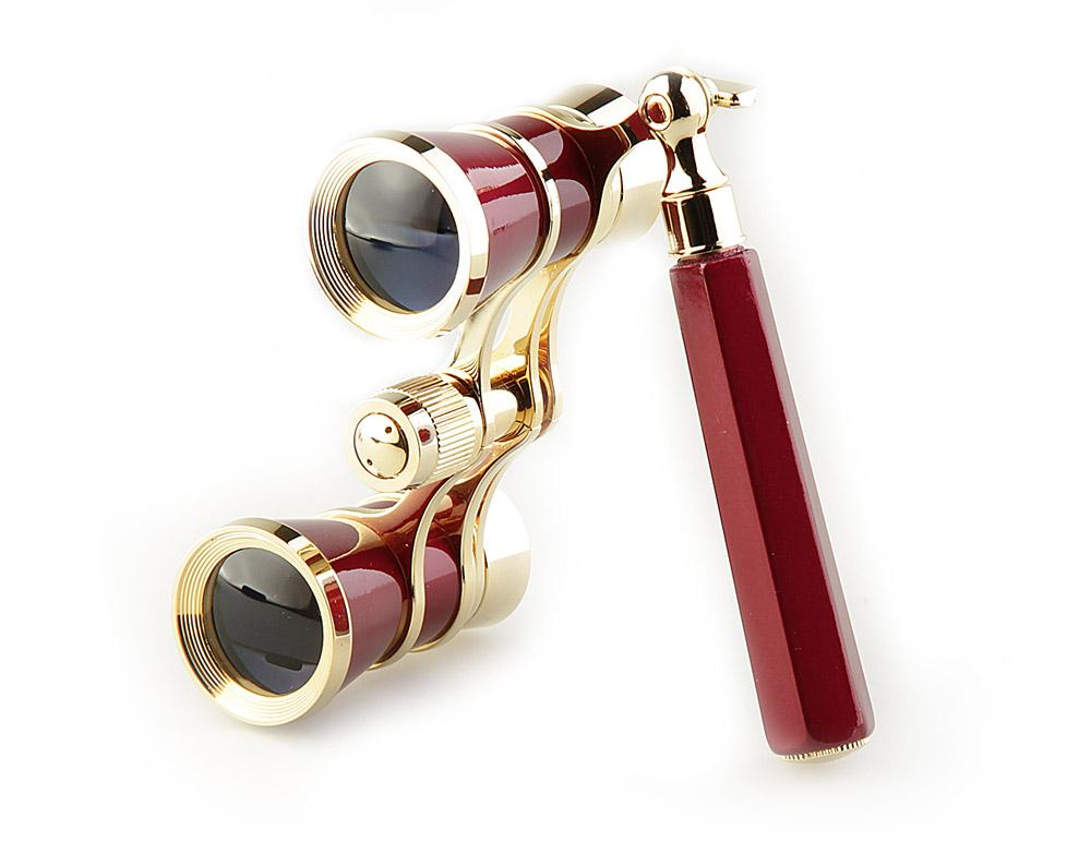 Бинокль Veber Opera, цвет: красный, БГЦ 3x25 E0810987Светосильный, корпус — металл, оптическое стекло с просветлением. Отделка глянцевым красным лаком и напыленным 18-ти каратным золотом. Регулируемое межзрачковое расстояние, фокусировка, лорнет. ОПИСАНИЕТеатральный бинокль Veber Opera БГЦ 3x25 (Лорнет) - не только изящный аксессуар, но и незаменимый помощник в наблюдениях театральных, цирковых, эстрадных представлений, верный спутник на экскурсиях. Классическая галилеевская оптическая схема с центральной внутренней фокусировкой, заключенная в красный лакированный корпус с позолоченными (18к) элементами. Трехкратное увеличение и широкое поле зрения позволят вам насладиться представлением даже с галерки. Длина телескопической ручки 10-16 см. Особенности Галилеевская оптическая система Центральная внутренняя фокусировка 3-х кратное увеличение Комплектация Бинокль Футляр-мешочек Ткань для протирки оптики Руководство по эксплуатации и гарантийный талон Характеристики Увеличение, крат 3 Диаметр объектива, мм 25 Вес, г 210 Цвет красный/золотой