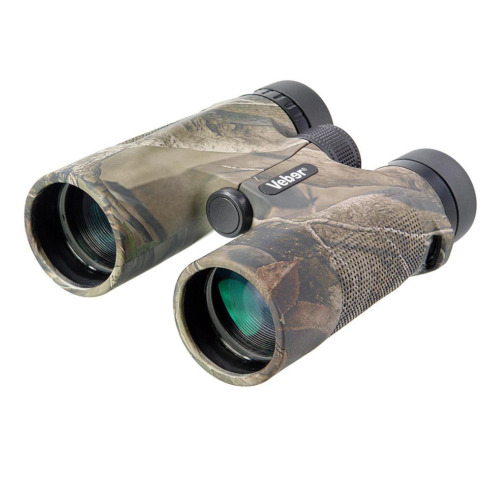Бинокль Veber Hunter, цвет: камуфляж, 10x4222489 Особенность конструкции — двойной мост, предохраняющий оптику от разъюстировки при ударах. С увеличением прибора в 10-крат легко рассмотреть удаленную цель в деталях. Легкий, с нетеряемыми крышками объективов, влагозащищенный, с возможностью смотреть в очках (с диоптриями или стрелковых), удобный в использовании одной рукой. Корпус камуфлированного цвета.ОПИСАНИЕ Этот бинокль спроектирован специально для охотников и учитывает их потребности в оптике, не заставляя переплачивать за «избыточное качество».Особенность бинокля — камуфляжный окрас корпуса. Прибор будет стильным дополнением охотничьего костюма и не станет демаскирующим фактором в лесу или на засидке.Кратность бинокля 10-x. С таким увеличением можно не только обнаружить и сопровождать цель, но и рассматривать ее в деталях. Светильные объективы диаметром 42 мм позволяют использовать бинокль в ближних сумерках. Корпус бинокля выполнен из противоударного (обрезиненного) пластика. Влагозащищенное исполнение. Бинокль имеет выдвижные бленды окуляров и удаленный выходной зрачок. Благодаря этому его можно использовать в обычных или спортивных очках. Ни один настоящий охотник не оставит дома такой бинокль!КомплектацияБинокль Veber HunterКрышки объективов (2 шт)Крышка окуляров спаренная (1 шт)Сумка-кофрТкань для протирки оптикиНашейный ремень для бинокляИнструкция и гарантийный талонХарактеристики Увеличение, крат 10Удаление выходного зрачка, мм 13.6Угловое поле зрения, град. 5.8Диаметр объектива, мм 42Линейное поле зрения (на расстоянии 1000 м), м 106Габаритные размеры, мм 154*125*54Вес, кг 0.570Цвет камуфлированныйМатериал корпуса пластикМатериал отделки корпуса резина