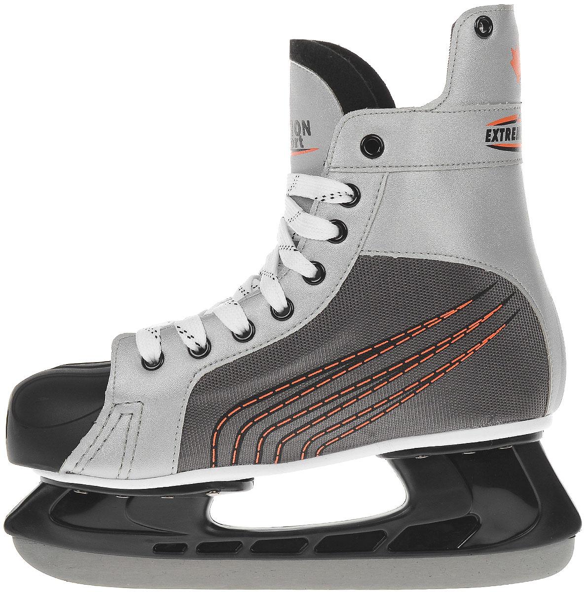 Хоккейные коньки торговой марки Action предназначены для игры в хоккей с шайбой или в хоккей с мячом. Наружная конструкция конька выполнена из нейлона и поливинилхлорида. Непокрытый, не требующий ухода мыс из пластика. Стойка лезвия - пластик.Удобный суппорт голеностопа. Лезвие изготовлено из нержавеющей стали со специальным покрытием, придающим дополнительную прочность.