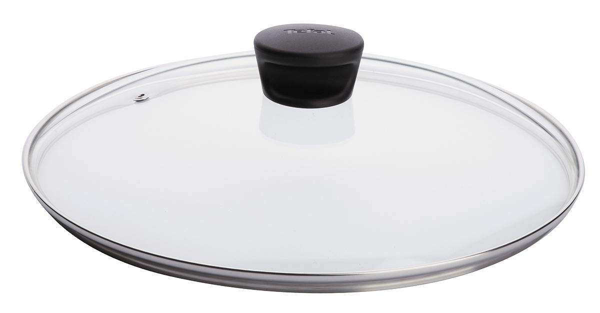 """Крышка """"Tefal"""" изготовлена из жаропрочного стекла. Обод, выполненный из высококачественной нержавеющей стали, защищает крышку от повреждений, а ручка, выполненная из бакелита, защищает ваши руки от высоких температур. Крышка удобна в использовании, позволяет контролировать процесс приготовления пищи. Имеется отверстие для выпуска пара. Крышка подходит для сковород и сотейников всех серий марки """"Tefal"""". Можно мыть в посудомоечной машине."""