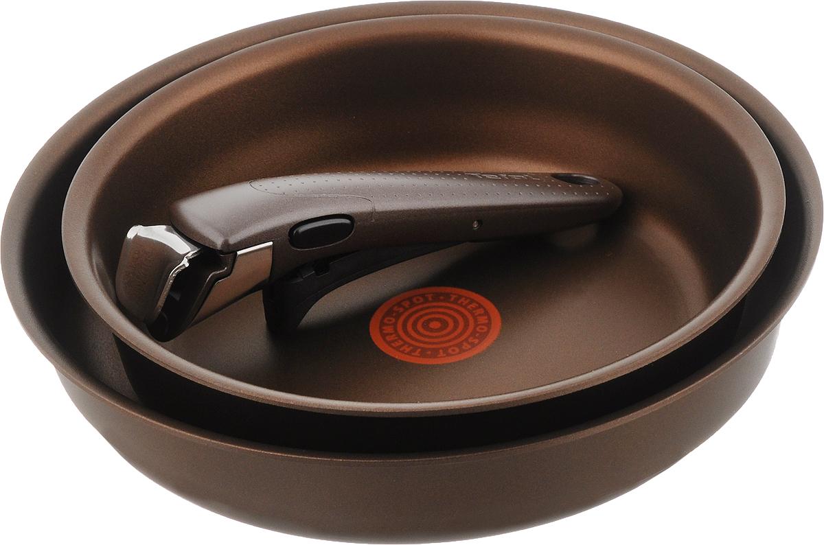 Набор сковородок Tefal Ingenio Authentic, с антипригарным покрытием, со съемной ручкой, 3 предметаL850S274Набор Tefal Ingenio Authentic состоит из 2 сковородок, изготовленных из литого алюминия с внутренним антипригарным покрытием Titanium PRO. Экстра - толстое дно для длительного сохранения тепла. Имеется индикатор нагрева Thermo-Spot, который становится равномерно красным при достижении оптимальной температуры. Мгновенное распределение тепла, устойчивость к деформации выше в 50 раз. Съемная ручка Ingenio 5 Premium выполнена из бакелита и выдерживает до десяти килограмм. Благодаря такой ручке посуда складывается друг в друга по принципу матрешки и хранится, занимая минимум места. К тому же, это значит, что сковороды можно использовать в духовке. С таким набором вы сможете готовить разнообразные блюда. Посуда занимает минимум места и дарит вам максимум возможностей.Можно мыть в посудомоечной машине. Подходит для всех типов плит, включая индукционные. Можно использовать в духовке с максимальной температурой нагрева 250°С (без ручки).Диаметр сковород: 22 см; 26 см. Высота стенки: 6,2 см, 5,7 см. Диаметр дна: 19 см; 23 см.Длина ручки: 18,5 см.