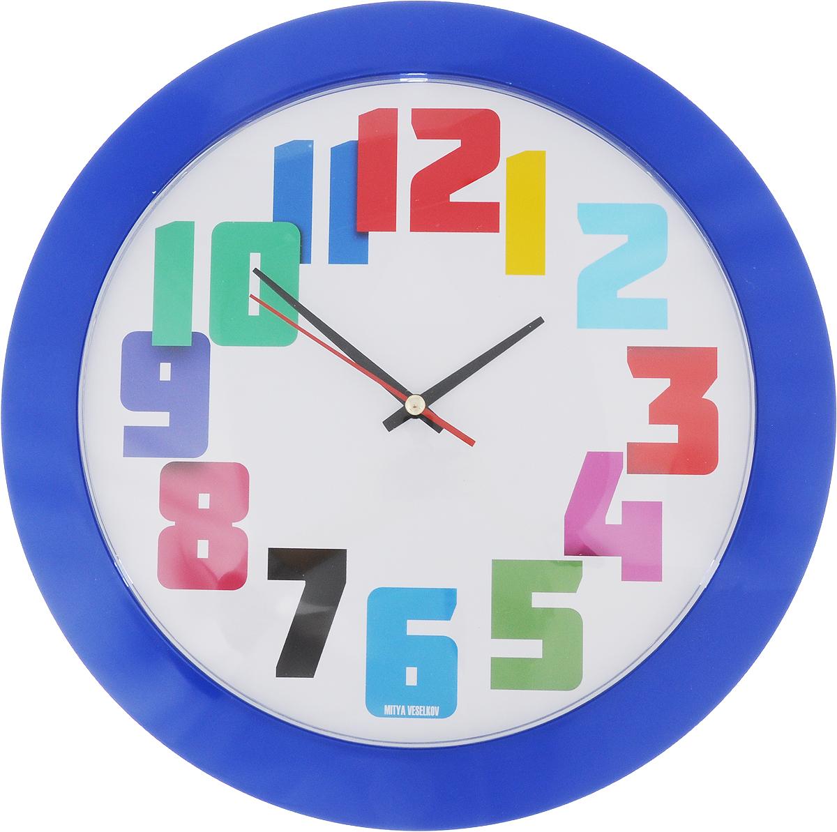 Часы настенные Mitya Veselkov Разноцветные цифры, цвет: синий, диаметр 30 смMVC.NAST-002Оригинальные настенные часы Mitya Veselkov Разноцветные цифры прекрасно дополнят интерьер комнаты. Круглый корпус часов выполнен из металла синего цвета. Циферблат защищен стеклом. Часы имеют три стрелки - часовую, минутную и секундную.Оформите свой дом таким интерьерным аксессуаром или преподнесите его в качестве презента друзьям, и они оценят ваш оригинальный вкус и неординарность подарка. Диаметр часов: 30 см. Толщина корпуса: 4 см. Часы работают от 1 батарейки типа АА (входит в комплект).