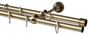 Карниз Эскар, комплектный, составной, двухрядный, цвет: латунь, диаметр 16/16 мм, длина 320 см9380016320Этот удобный 2-рядный карниз для штор и тюля изготовлен из металла. Минималистическое оформление позволяет перенести акцент на функциональные особенности изделия. В любом интерьере такой стильный карниз выглядит эффектно. Комплект также включает в себя кольца, торцевые заглушки, кронштейны и другие элементы для монтажа. Наконечники приобретаются отдельно.