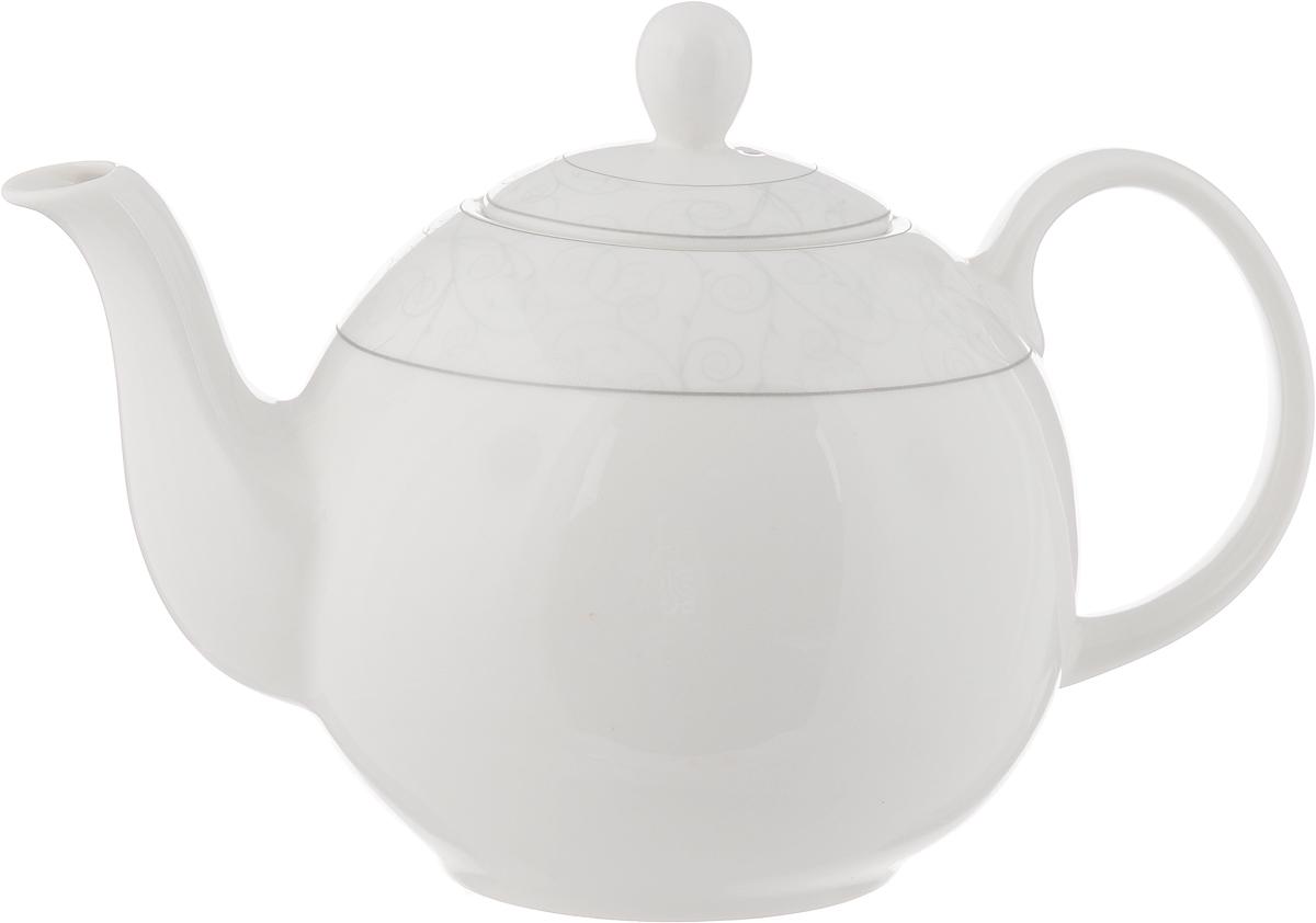 Чайник заварочный Esprado Florestina, 1,22 лFLOL12SE306Чайник заварочный Esprado Florestina изготовлен из высококачественного костяного фарфора и декорирован изящным узором по верхнему краю. Такой дизайн, несомненно, придется по вкусу и любителям классики, и тем кто предпочитает современный стиль. Такой чайник украсит ваш кухонный стол, а также станет замечательным подарком к любому празднику. Можно использовать в микроволновой печи и мыть в посудомоечной машине.Диаметр чайника (по верхнему краю): 5,5 см.Высота чайника (с учетом крышки): 15 см.Длина чайника (с учетом ручки и носика): 21 см.