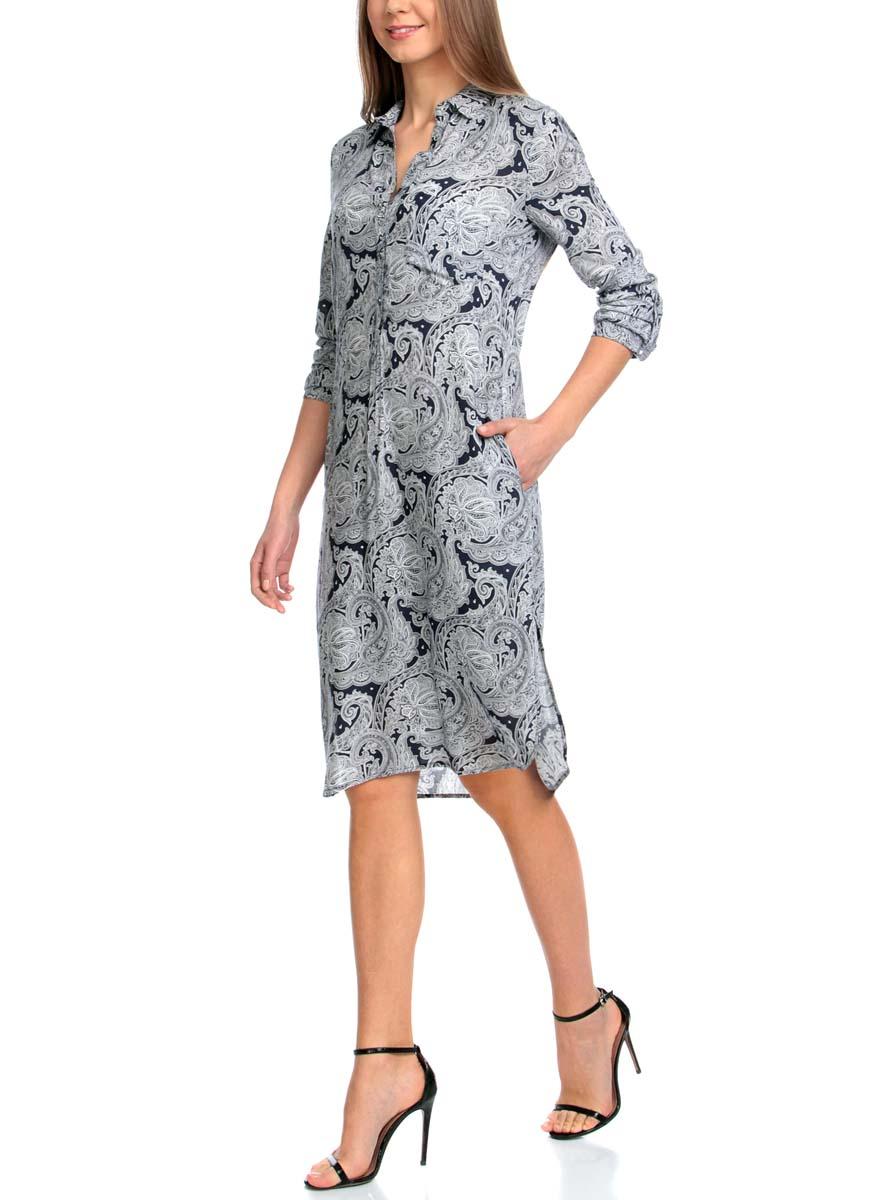 Платье oodji Collection, цвет: темно-синий, белый. 21900318-2/42127/7912E. Размер 44-170 (50-170)21900318-2/42127/7912EМодное платье oodji Collection станет отличным дополнением к вашему гардеробу. Модель выполнена из качественной вискозы. Платье-миди с отложным воротником и длинными рукавами застегивается спереди на шесть пуговиц. Манжеты на рукавах также имеют застежки-пуговицы. Оформлено изделие на груди накладным карманом и по бокам дополнено небольшими разрезами. Выполнено платье принтом с узорами.