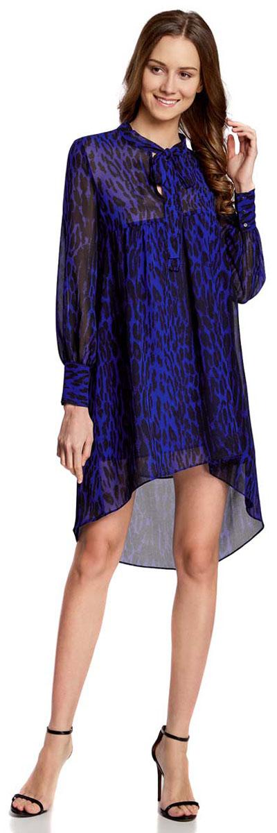 Платье oodji Ultra, цвет: индиго, черный. 11913032/38375/7829A. Размер 38-170 (44-170)11913032/38375/7829AПлатье oodji Ultra исполнено из воздушной, легкой ткани. Имеет свободный крой и V-образный вырез воротника, оформленный завязками под горлом. Платье выполнено с длинными рукавами-баллонами, застегивающимися на манжетах на пуговицы и ассиметричной юбкой, удлиненной сзади шлейфом.