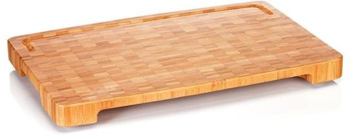 Доска разделочная Tescoma Azza, 40 x 26 см379890Массивная разделочная дочка Tescoma Azza, выполненная из нескольких слоев натурального бамбука, прекрасно подходит для нарезки, порцевания или отбивания пищевых продуктов. Выемка на нижней части доски позволяет задвинуть тарелку или поднос для легкого переноса нарезанных пищевых продуктов. Разделочная доска наклонена к желобу для стекания жидкости. Изделие оснащено удобными ручками для безопасной манипуляции с противоскользящей обработкой. Нельзя мыть в посудомоечной машине.
