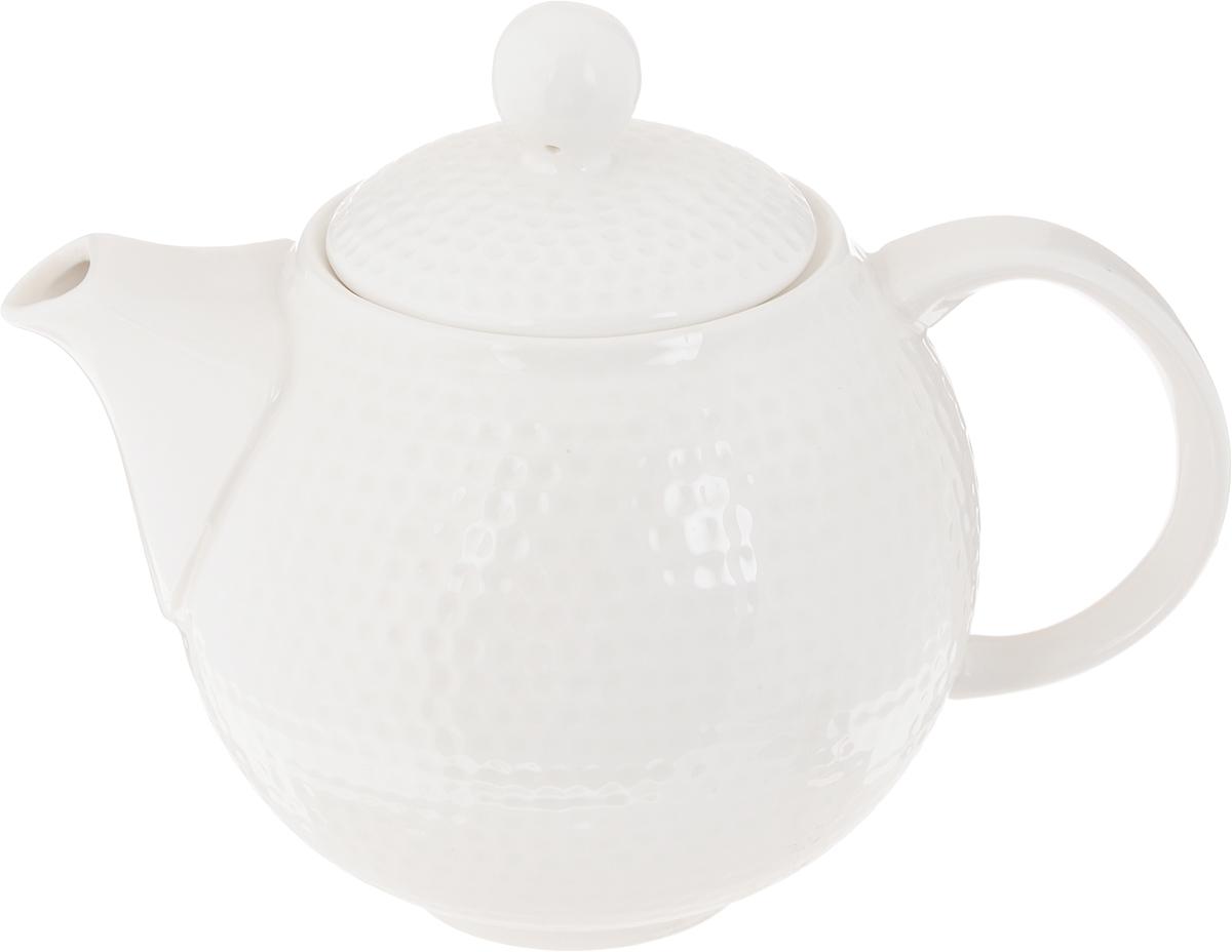 Чайник заварочный Claude Monet, 900 мл596-046Заварочный чайник Claude Monet изготовлен из высококачественного фарфора. Глазурованное покрытие обеспечивает легкую очистку. Изделие прекрасно подходит для заваривания вкусного и ароматного чая, а также травяных настоев. Отверстия в основании носика препятствует попаданию чаинок в чашку. Оригинальный дизайн сделает чайник настоящим украшением стола. Он удобен в использовании и понравится каждому.Можно мыть в посудомоечной машине и использовать в микроволновой печи. Диаметр чайника (по верхнему краю): 8 см. Ширина чайника (с учетом носика и ручки): 19 см. Высота чайника (без учета крышки): 11,5 см. Высота чайника (с учетом крышки): 15,5 см.