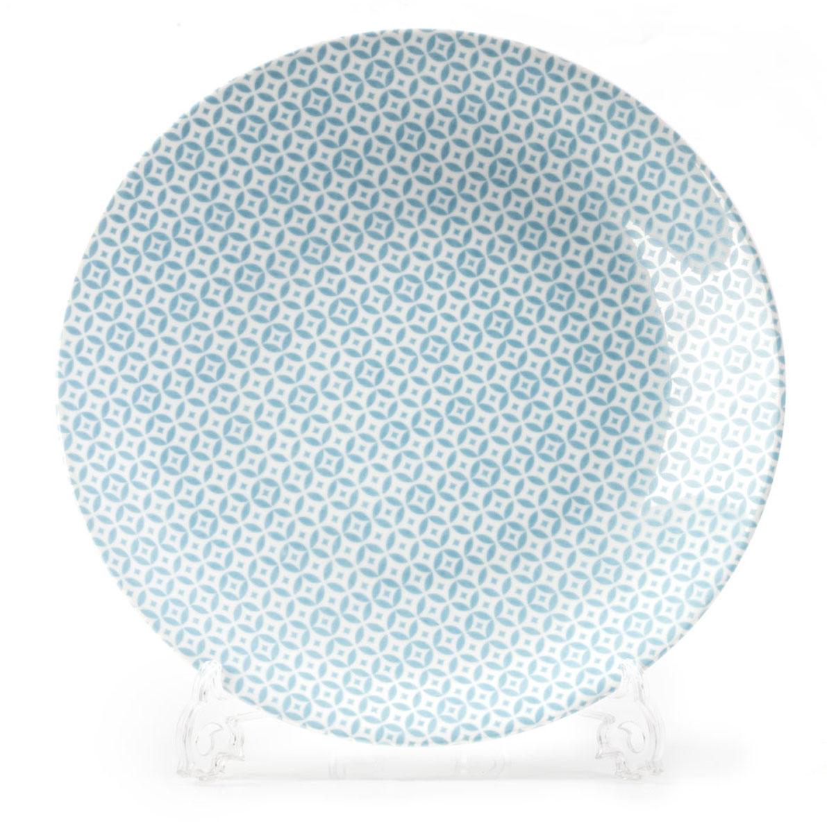 Тарелка La Rose des Sables Витон, цвет: голубой, диаметр 27 см720127 2303Тарелка La Rose des Sables Витон выполнена из тунисского фарфора, изготовленного из уникальной белой глины, которую добывают во французской провинции Лимож. Фарфоровая тарелка из знаменитой Лиможской глины. Фарфор превосходного качества. Благодаря двойному термическому обжигу, этот тонкостенный фарфор обладает высокой ударопрочностью, жаропрочностью и великолепным блеском глазури. Тарелка идеально подходит для повседневного использования. Отлично смотрится в любом интерьере.Можно использовать в СВЧ печи и мыть в посудомоечной машине. Диаметр: 27 см.