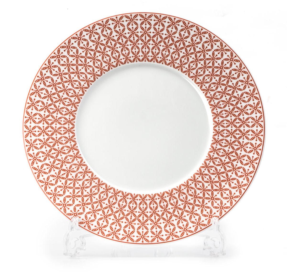 Тарелка La Rose des Sables Ажур, цвет: красный, белый, диаметр 27 см830127 2301Тарелка La Rose des Sables Ажур выполнена из высококачественного тунисского фарфора, изготовленного из уникальной белой глины. На всех изделиях La Rose des Sables можно увидеть маркировку Pate de Limoges. Это означает, что сырье для изготовления фарфора добывают во французской провинции Лимож, и качество соответствует высоким европейским стандартам. Все производство расположено в Тунисе. Особые свойства этой глины, открытые еще в 18 веке, позволяют создать удивительно тонкую, легкую и при этом прочную посуду. Благодаря двойному термическому обжигу фарфор обладает высокой ударопрочностью, стойкостью к сколам и трещинам, жаропрочностью и великолепным блеском глазури. Коллекция Ажур - это изысканная классика, дополненная красивым орнаментом по всей поверхности. Эта фарфоровая посуда станет настоящим украшением вашего стола. Прекрасный вариант как для праздничной, так и для повседневной сервировки стола. Можно использовать в СВЧ печи и мыть в посудомоечной машине.