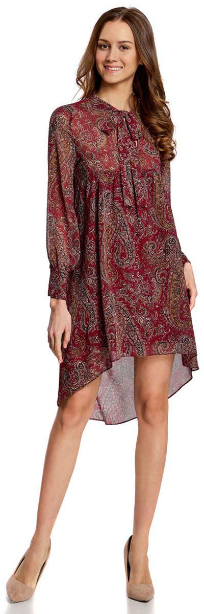 Платье oodji Ultra, цвет: бордовый, коричневый. 11913032/38375/4912E. Размер 44-170 (50-170)11913032/38375/4912EПлатье oodji Ultra исполнено из воздушной, легкой ткани. Имеет свободный крой и V-образный вырез воротника, оформленный завязками под горлом. Платье выполнено с длинными рукавами-баллонами, застегивающимися на манжетах на пуговицы и ассиметричной юбкой, удлиненной сзади шлейфом.