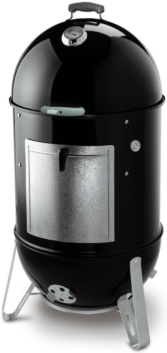 Коптильня Weber Smokey Mountain Cooker, цвет: черный, 47 см721004Smokey Mountain Cooker - уникальная барбекю коптильня от Weber. Попробуйте приготовить любимые блюда с помощью этого гриля и результат будет превосходным. Можно использовать как шашлычницу и барбекю или как коптильню. Кастрюля с фарфоровым покрытием для воды добавляет пар в процессе приготовления, что делает приготавливаемое блюдо более сочным и нежным.Эмалированный шар, крышка и кастрюля для воды; Нержавеющие алюминиевые вентили; Огнестойкая дверца; Укрепленная стеклом нейлоновая ручка.