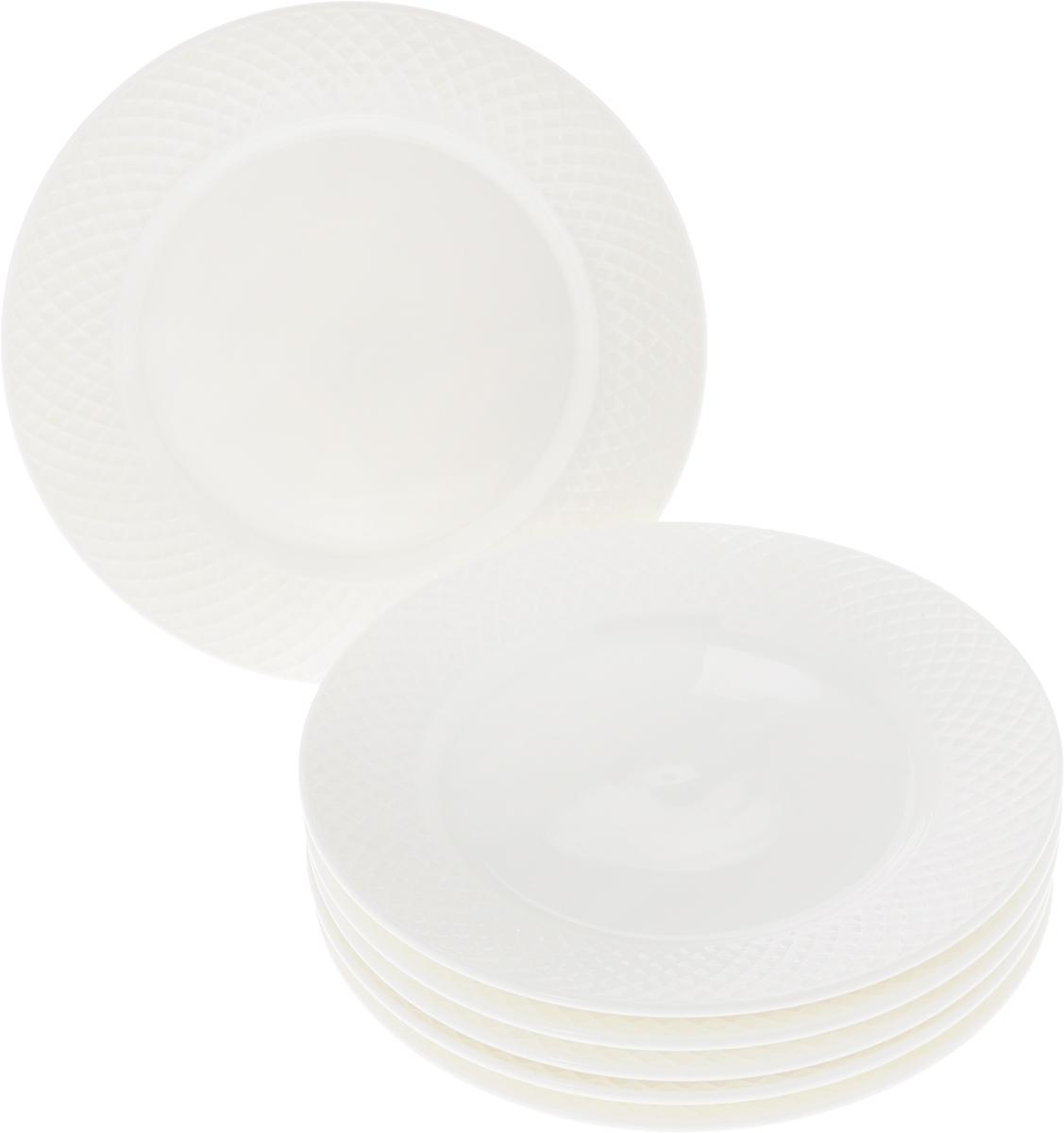 Набор тарелок Wilmax, диаметр 20 см, 6 предметовWL-880100-JV / 6CНабор Wilmax состоит из 6 десертныхтарелок. Изделия выполнены из высококачественного фарфораи имеют классическую круглую форму.Такой набор прекрасно подойдет как для повседневногоиспользования, так и для праздников.Набор тарелок Wilmax - это не только полезный подарок дляродных и близких, а также великолепное дизайнерскоерешение для вашей кухни или столовой.Диаметр десертной тарелки: 20 см.Высота десертной тарелки: 2 см.