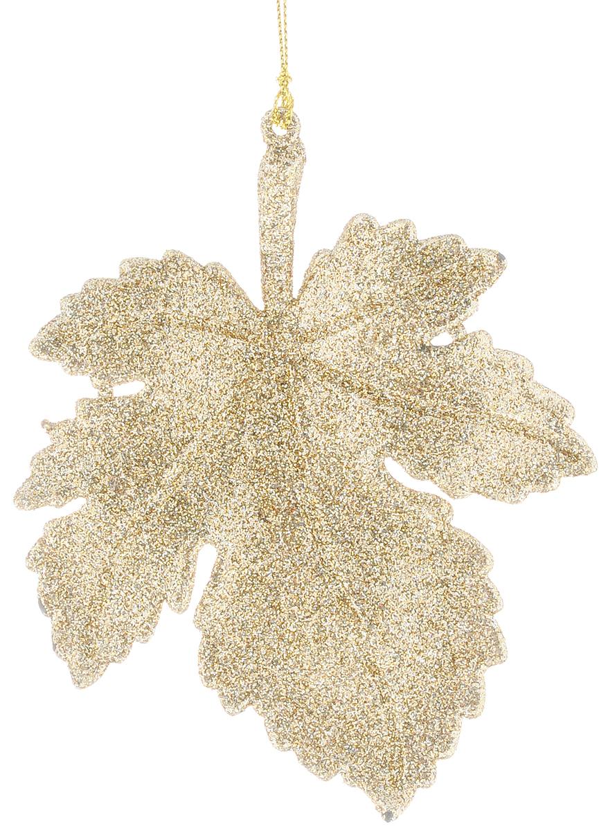 Украшение новогоднее подвесное Magic Time Листочек, цвет: золотистый, 14 х 11,1 см38712_золотистыйНовогоднее украшение Magic Time Листочек отлично подойдет для декорации вашего дома и новогодней ели. Украшение выполнено из высококачественного пластика и оформлено блестками. Изделие оснащено текстильной петелькой, с помощью которой его можно повесить в любом понравившемся вам месте. Елочная игрушка - символ Нового года. Она несет в себе волшебство и красоту праздника. Создайте в своем доме атмосферу веселья и радости, украшая всей семьей новогоднюю елку нарядными игрушками, которые будут из года в год накапливать теплоту воспоминаний.