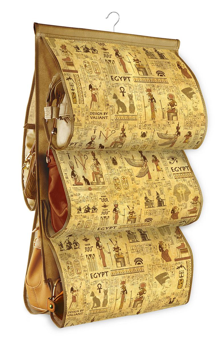 Кофр подвесной для сумок Valiant Egypt, с вешалкой, 5 секций, 42 х 72 смEG-P5Подвесной кофр Valiant Egypt, изготовленный из высококачественного нетканого материала соригинальным принтом, предназначен для хранения сумок.Благодаря специальному крючку, кофр можно повесить в шкафу как обычную вешалку, аэстетичный дизайн гармонично смотрится в любом интерьере. Изделие имеет 5 секций.Подвесной кофр Ренессанс - это новый взгляд на систему хранения - теперь хранить вещи нетолько удобно, но и красиво. Размер кофра: 42 х 72 см.Количество секций: 5.