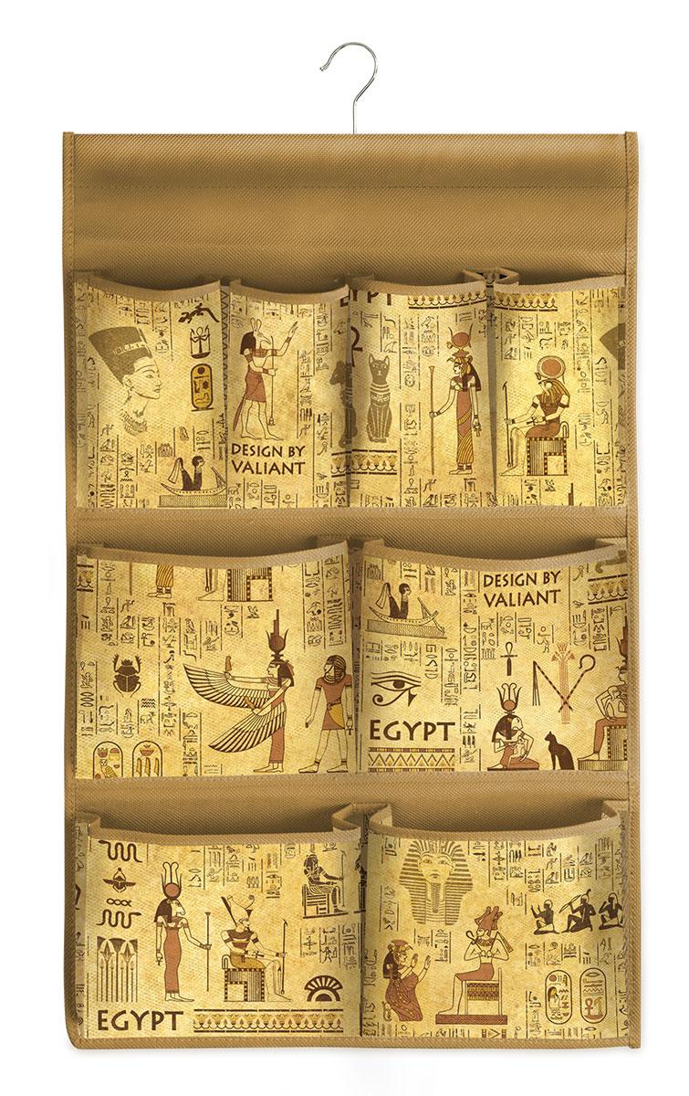 """Подвесной кофр Valiant """"Egypt"""", изготовленный из высококачественного нетканого материала с оригинальным принтом. Благодаря специальному крючку, кофр можно повесить в шкафу как обычную вешалку, а эстетичный дизайн гармонично смотрится в любом интерьере. Изделие имеет 8 карманов. Подвесной кофр """"Vintage"""" - это новый взгляд на систему хранения - теперь хранить вещи не только удобно, но и красиво.Размер кофра: 36 х 80 см."""