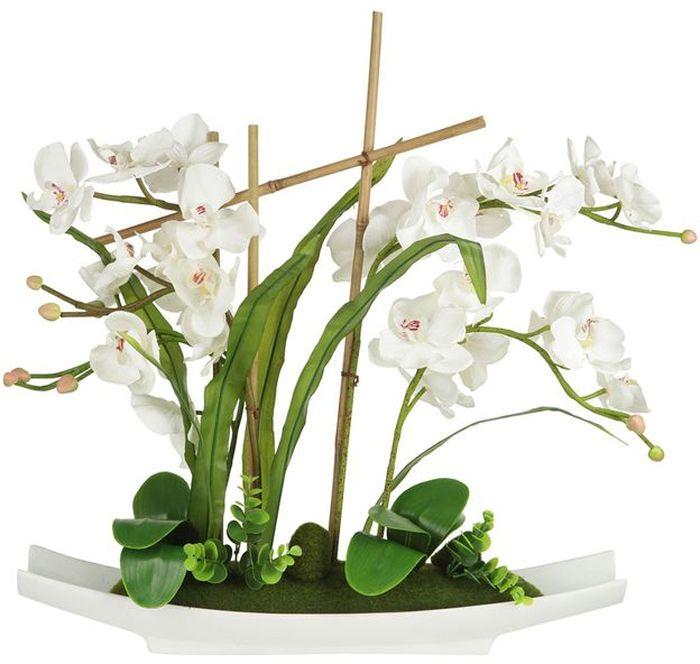 """Декор.цветы """"Орхидея белая"""" на керам подставке 56х11х58смТорговая марка """"Dream Garden"""", Китай.   Композиции из искусственных цветов долговечны, не требуют ежедневного ухода, выполнены из натуральных шелка и текстиля, прошедших специальную обработку высококачественными современными материалами. Искусственные цветы максимально приближены к натуральным, не пахнут, что исключает все аллергические реакции."""