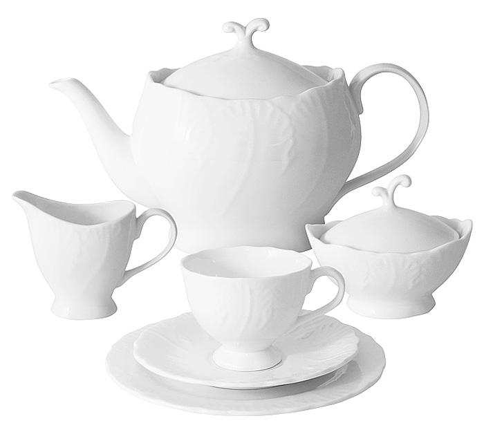 Чайный сервиз Emerald Белый город, 21 предметE6-SM077/21ALОригинальный чайный сервиз Emerald Белый город состоит из 6 чашек, 6 блюдец, 6 десертных тарелок, чайника, сахарницы и молочника. Изделия изготовлены из высококачественного костяного фарфора. Поверхность изделий покрыта превосходной сверкающей глазурью, не содержащей свинца.Благодаря высокому качеству исполнения, разнообразным декорам и оптимальному соотношению цена/качество, посуда Emerald завоевала огромную популярность у покупателей и пользуется неизменно высоким спросом. Такой сервиз придется по вкусу любителям классики, и тем, кто предпочитает утонченность и изысканность. Объем чайника: 1000 мл. Объем сахарницы: 100 мл. Объем молочника: 100 мл.Объем чашек: 150 мл.Диаметр тарелок: 19 см.