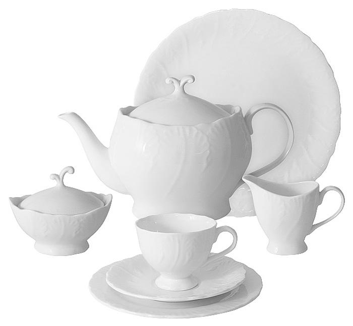 Чайный сервиз Emerald Белый город, 40 предметов, 12 персон. E6-SM077/40ALE6-SM077/40ALЧайный сервиз Белый город 40 предметов на 12 персон (12 чашек 0,15л; 12 блюдец; 12 тарелок 19см, чайник1,0л, сахарница 0,1л, молочник 0,1л, блюдо 42х21см)Чайная и обеденная столовая посуда торговой марки Emerald произведена из высококачественного костяного фарфора. Благодаря высокому качеству исполнения, разнообразным декорам и оптимальному соотношению цена – качество, посуда Emerald завоевала огромную популярность у покупателей и пользуется неизменно высоким спросом.Изделия Emerald представлены как в виде обеденных и чайных сервизов на 6 и 12 персон.Поверхность изделий покрыта превосходной сверкающей глазурью, не содержащей свинца.