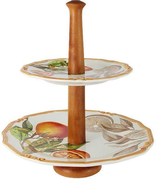 Ваза для фруктов LCS Апельсины, двухъярусная, цвет: коричневый, белый, 30 х 33 см. LCS030-AR-ALLCS030-AR-ALДвухъярусная ваза для фруктов LCS Апельсины - изделие высокого технологичного производства с использованием ручной работы профессиональных дизайнеров и художников. Она выполнена из высококачественной керамики и предназначена для красивой сервировки фруктов и десертов. Ярусы вазы декорированы изысканным изображением фруктов. Держатель вазы выполнен из дерева. Изделие украсит сервировку вашего стола и подчеркнет прекрасный вкус хозяина.LCS - молодая, динамично развивающаяся итальянская компания из Флоренции, производящая разнообразную керамическую посуду и изделия для украшения интерьера.