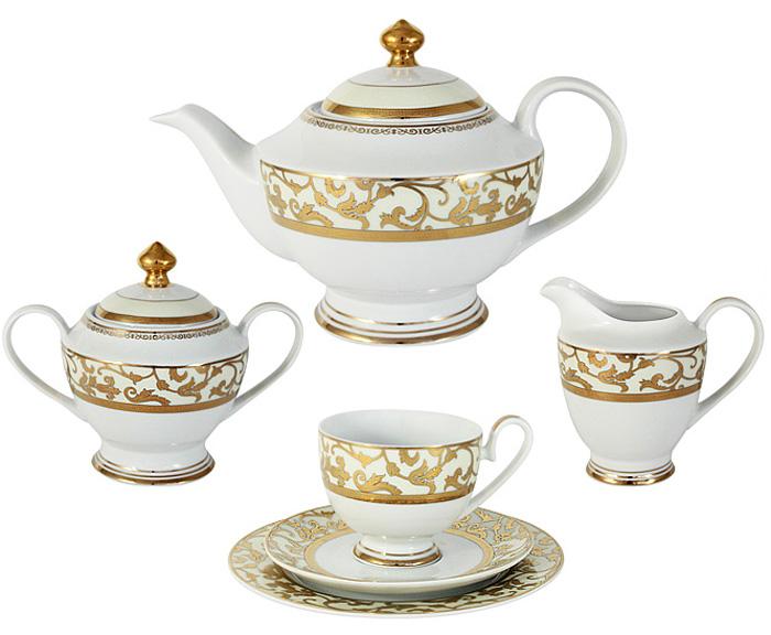 Чайный сервиз Midori Толедо, цвет: кремовый, 23 предмета, 6 персон. MI2-K6892-Y6/23B-Cr-ALMI2-K6892-Y6/23B-Cr-ALЧайный сервиз Толедо (кремовый) 23 предмета на 6 персон (6 чашек 0,2л,6 блюдец,6 тарелок 19см, чайник с крышкой 1,5л, сахарница с крышкой 0,35л, сливочник 0,3л)Фарфоровая посуда всегда была признаком хорошего стиля, роскоши и достатка. Великолепные фарфоровые сервизы украшали званые ужины в домах аристократов, художественная ценность некоторых изделий из фарфора настолько высока, что они хранятся в музеях, как настоящие произведения искусства. Сегодня традиция сервировать праздничный стол утонченной посудой из фарфора возвращается в наши дома. Она придает торжественности каждому событию, будь то свадьба, юбилей или встреча старых друзей.Предлагаем вашему вниманию столовые и чайные сервизы из высококачественного твердого фарфора торговой марки Midori. Великолепные орнаменты, серебряные и золотые узоры выглядят празднично и роскошно. Для сервизов торговой марки Midori характерна филигранная работа и высокохудожественное исполнение декоров. Фарфор достоин представления во дворцах и президентских апартаментах.