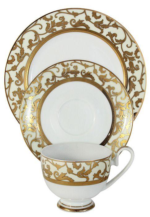 Набор чайный Midori Толедо, цвет: кремовый, 3 предмета. MI2-K6892-Y6/3/Cr-ALMI2-K6892-Y6/3/Cr-ALНабор из 3-х предметов Толедо (кремовый): чашка 0,2л, блюдце, десертная тарелка 19смФарфоровая посуда всегда была признаком хорошего стиля, роскоши и достатка. Великолепные фарфоровые сервизы украшали званые ужины в домах аристократов, художественная ценность некоторых изделий из фарфора настолько высока, что они хранятся в музеях, как настоящие произведения искусства. Сегодня традиция сервировать праздничный стол утонченной посудой из фарфора возвращается в наши дома. Она придает торжественности каждому событию, будь то свадьба, юбилей или встреча старых друзей.Предлагаем вашему вниманию столовые и чайные сервизы из высококачественного твердого фарфора торговой марки Midori. Великолепные орнаменты, серебряные и золотые узоры выглядят празднично и роскошно. Для сервизов торговой марки Midori характерна филигранная работа и высокохудожественное исполнение декоров. Фарфор достоин представления во дворцах и президентских апартаментах.