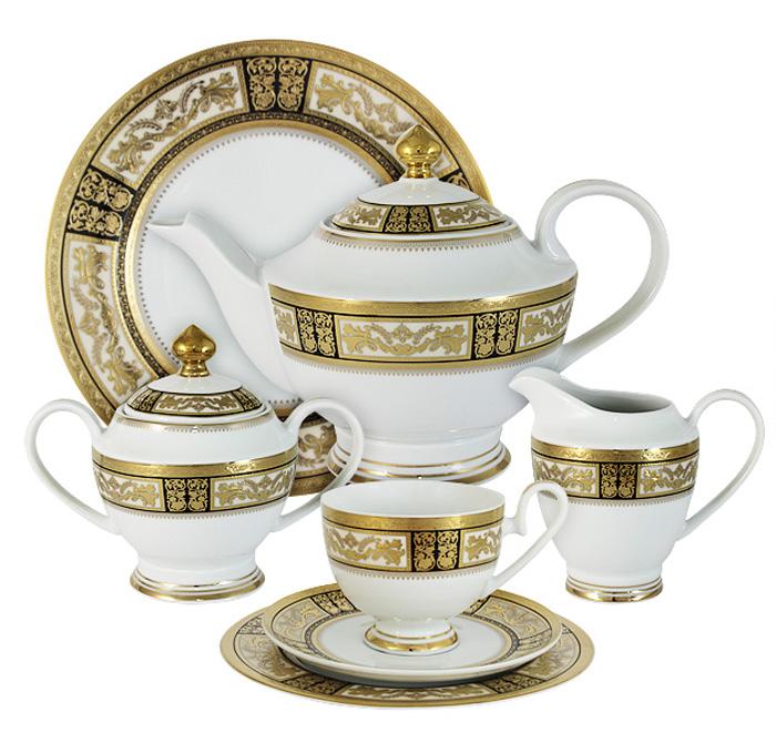 Чайный сервиз Midori Елизавета, 42 предмета, 12 персон. MI2-K7703-Y7/42A-ALMI2-K7703-Y7/42A-ALЧайный сервиз Елизавета 42 предмета на 12 персон (12 чашек 0,2л,12 блюдец,12 тарелок 19см, сливочник 0,3л, сахарница с крышкой 0,45л, блюдо 27см, чайник с крышкой 1,4л)Фарфоровая посуда всегда была признаком хорошего стиля, роскоши и достатка. Великолепные фарфоровые сервизы украшали званые ужины в домах аристократов, художественная ценность некоторых изделий из фарфора настолько высока, что они хранятся в музеях, как настоящие произведения искусства. Сегодня традиция сервировать праздничный стол утонченной посудой из фарфора возвращается в наши дома. Она придает торжественности каждому событию, будь то свадьба, юбилей или встреча старых друзей.Предлагаем вашему вниманию столовые и чайные сервизы из высококачественного твердого фарфора торговой марки Midori. Великолепные орнаменты, серебряные и золотые узоры выглядят празднично и роскошно. Для сервизов торговой марки Midori характерна филигранная работа и высокохудожественное исполнение декоров. Фарфор достоин представления во дворцах и президентских апартаментах.