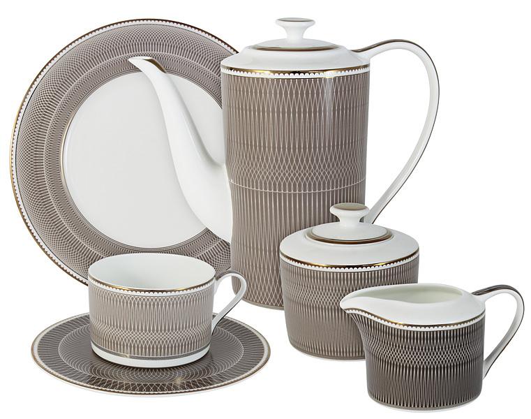 """Чайный сервиз """"Мокко"""" 21 предм.на 6 персон (6 чашек 0.25л, 6 блюдец, 6 тарелок 21.5см, чайник 1.4л, сахарница 0.35л, молочник 0.25л )Чайная и обеденная посуда торговой марки Naomi из высококачественного костяного фарфора отличается прекрасными дизайнами, исполненными как в современном, так и в классическом стиле по разработкам современных японских художников. Все изделия изготавливаются на современном оборудовании по новейшим технологиям и проходят строгий контроль качества."""